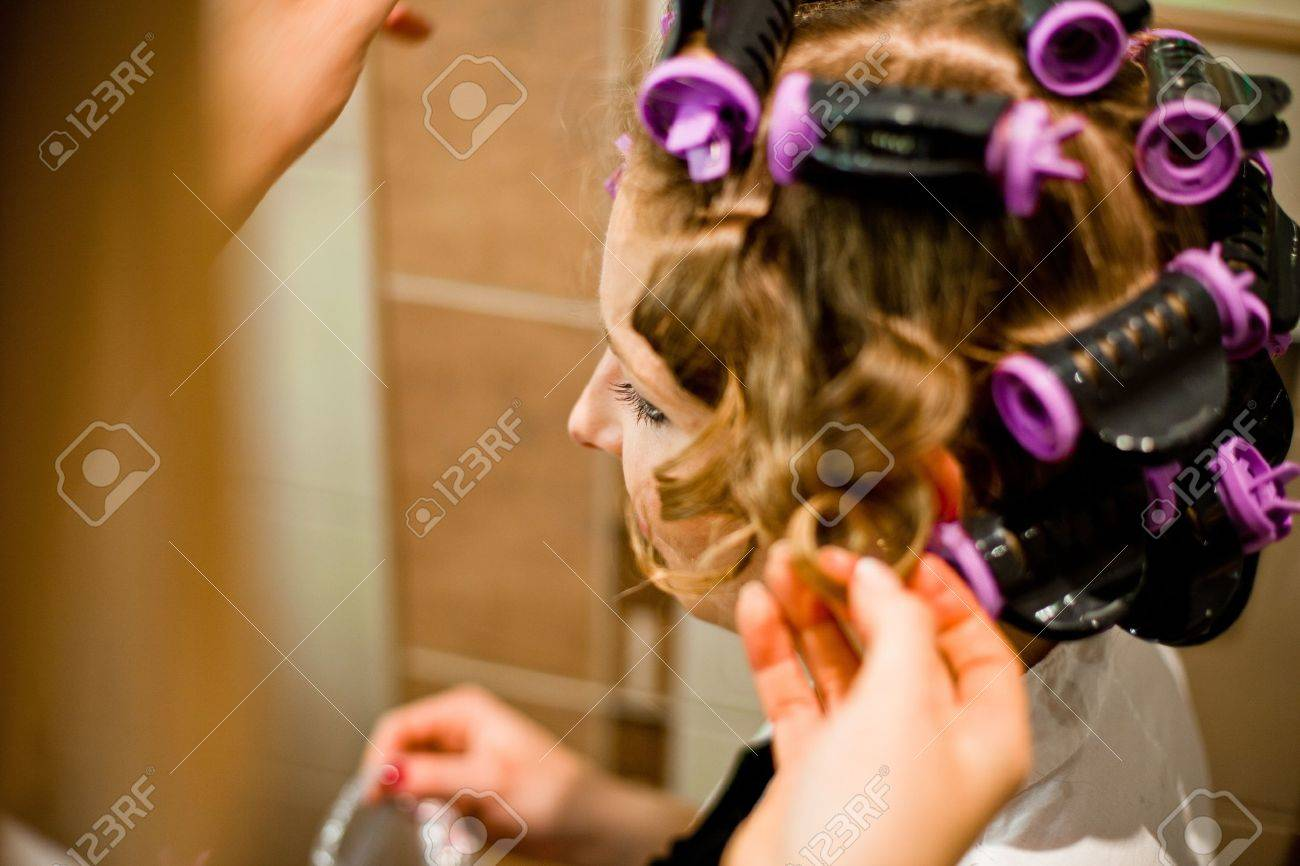 Woman curling hair Stock Photo - 11745220