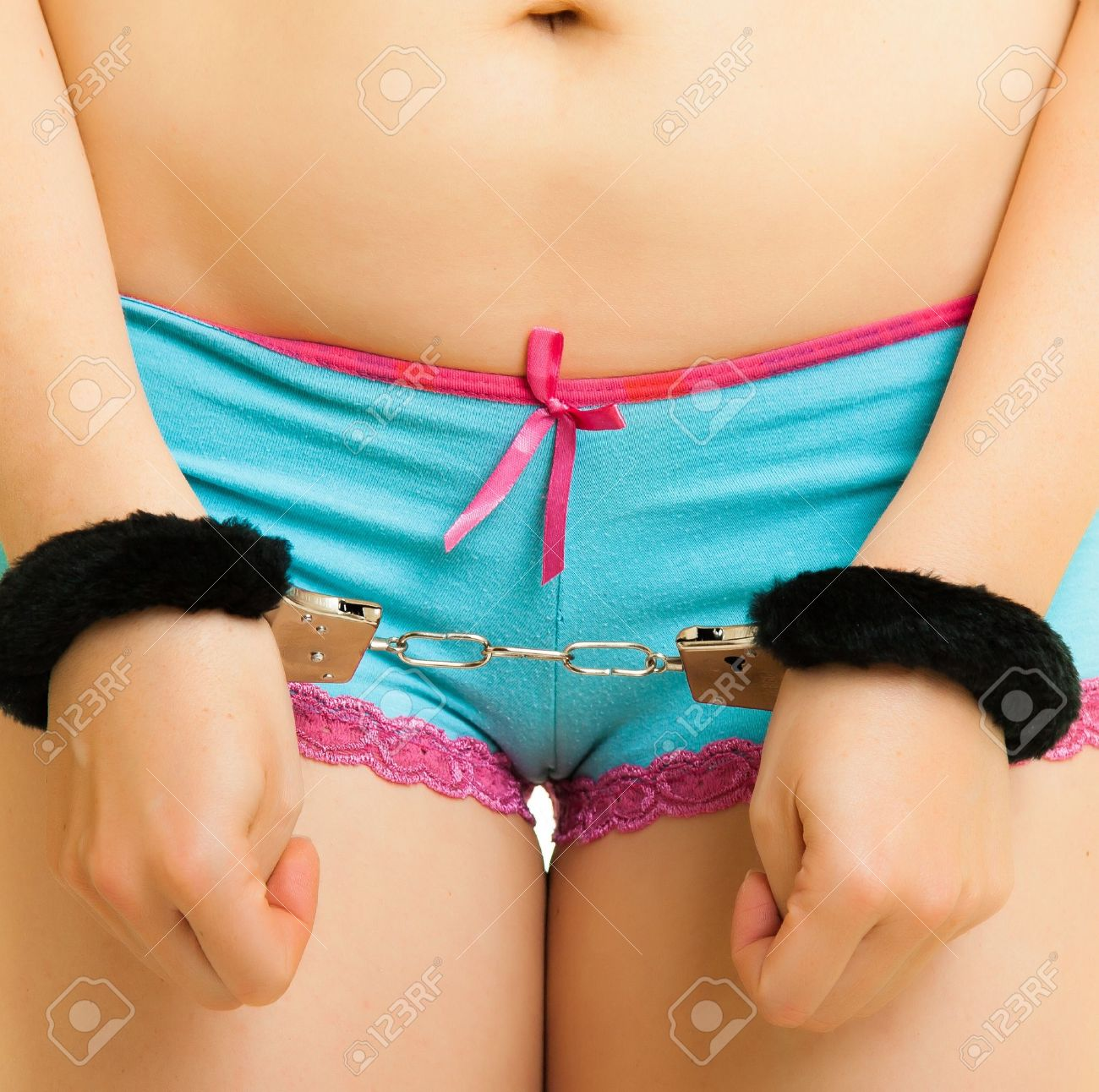 Girl in panties and handcuffs isolated on white Stock Photo - 13241225