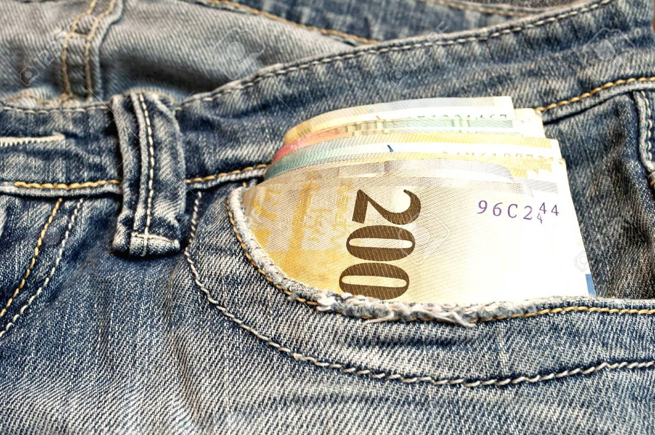 Money in front-pocket of jeans  Swiss Franc bank note Stock Photo - 17380790