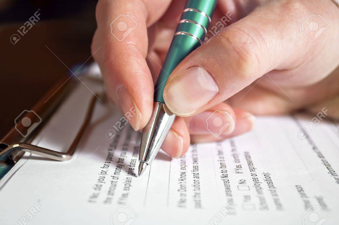 Concept of signing loan agreement with pen in hand Stock Photo - 17544766