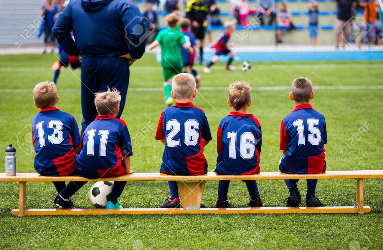 Football soccer match for children. Kids waiting on a bench. - 50563122