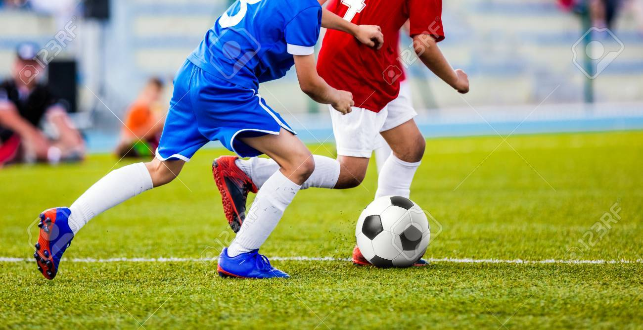 50df5b539 Football Match for Children. Kids Playing Soccer Tournament Game. Boys  Running and Kicking Football