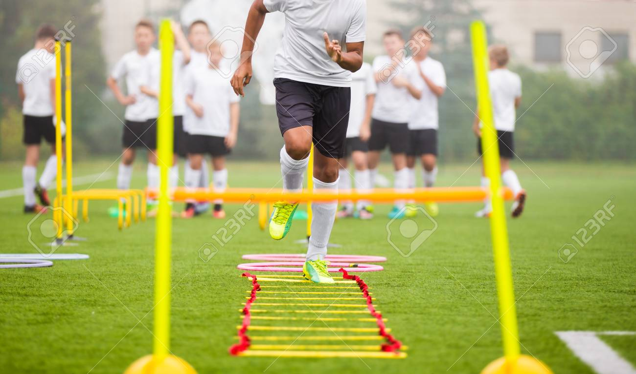 Boy Soccer Player In Training. Young Soccer Players at Practice Session - 87548338