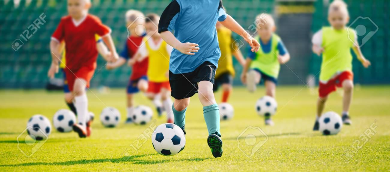 d3314a7bb Football soccer training for kids. Children football training session. Kids  running and kicking soccer