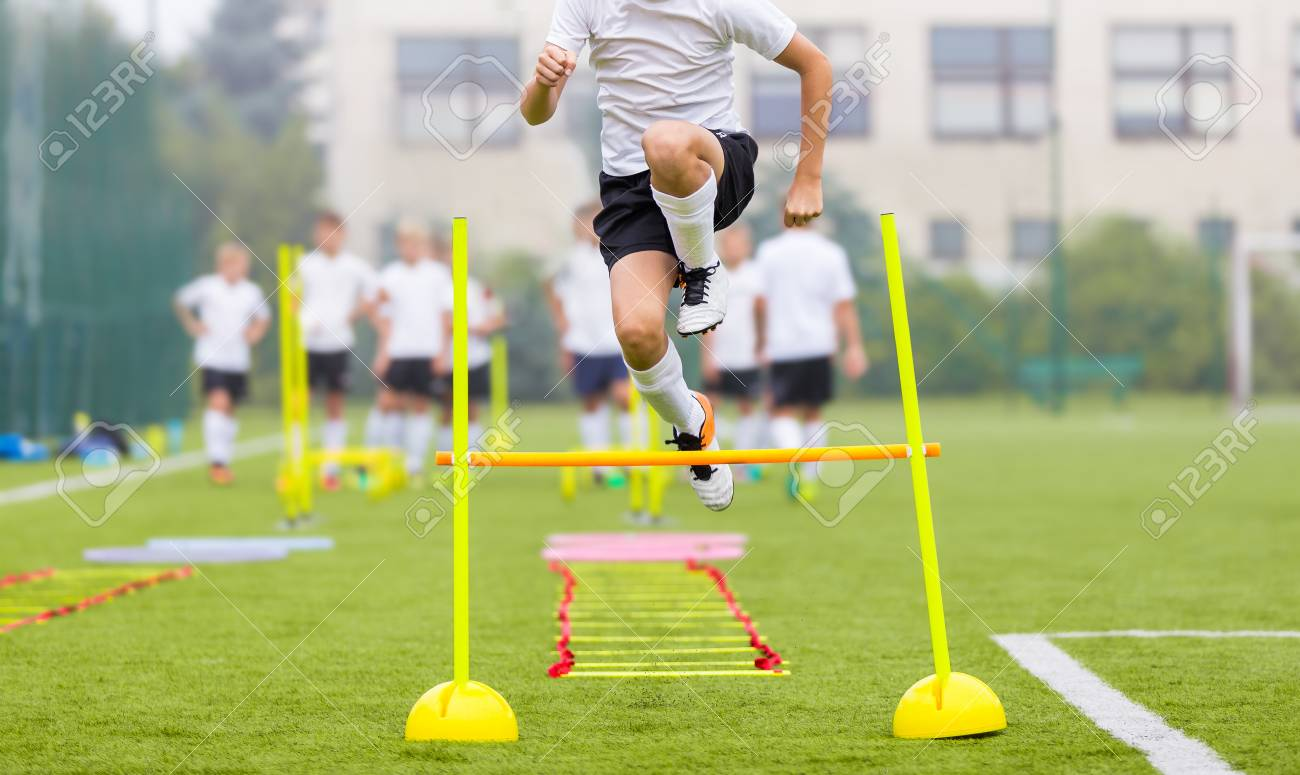 Soccer Player on Fitness Training  Footballers on Practice Session
