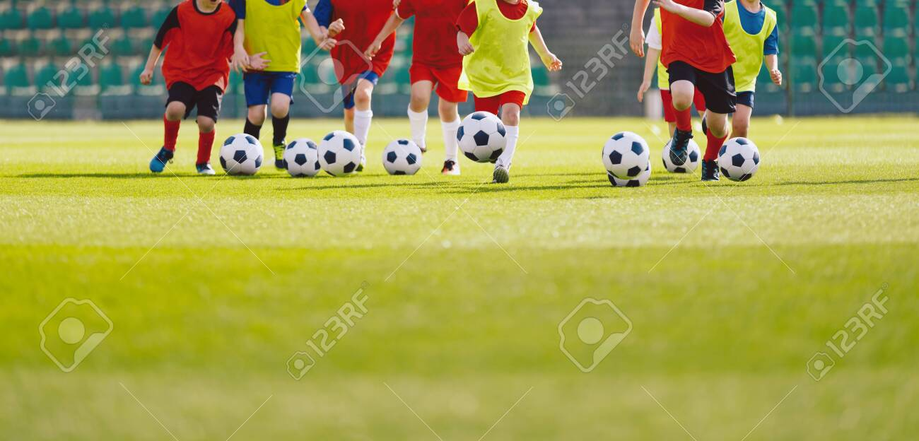 Children football training session. Kids running and kicking soccer balls. Young boys improving soccer skills. Football soccer training for kids - 151922385