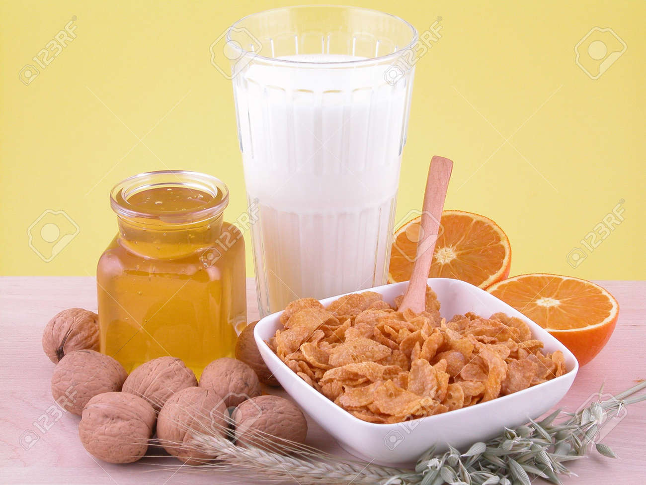 bowl of cornflakes and milk with honey and walnuts Stock Photo - 460201