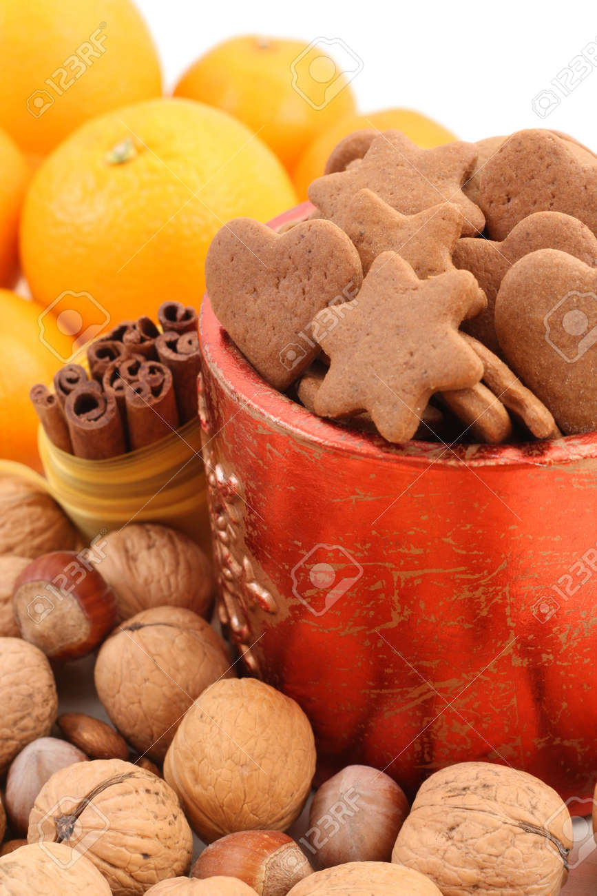 bowl of delicious gingerbreads and some fruits Stock Photo - 2247640