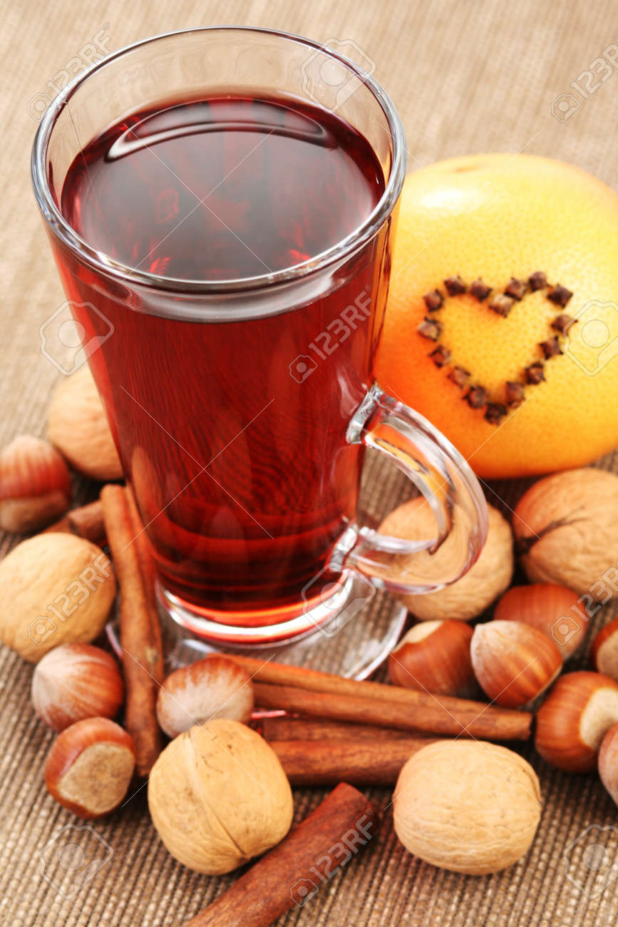 glass of hot wine with orange and spices Stock Photo - 8935896
