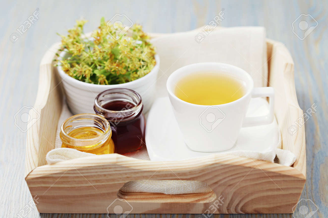 cup of tea and linden flowers - tea time Stock Photo - 10343001