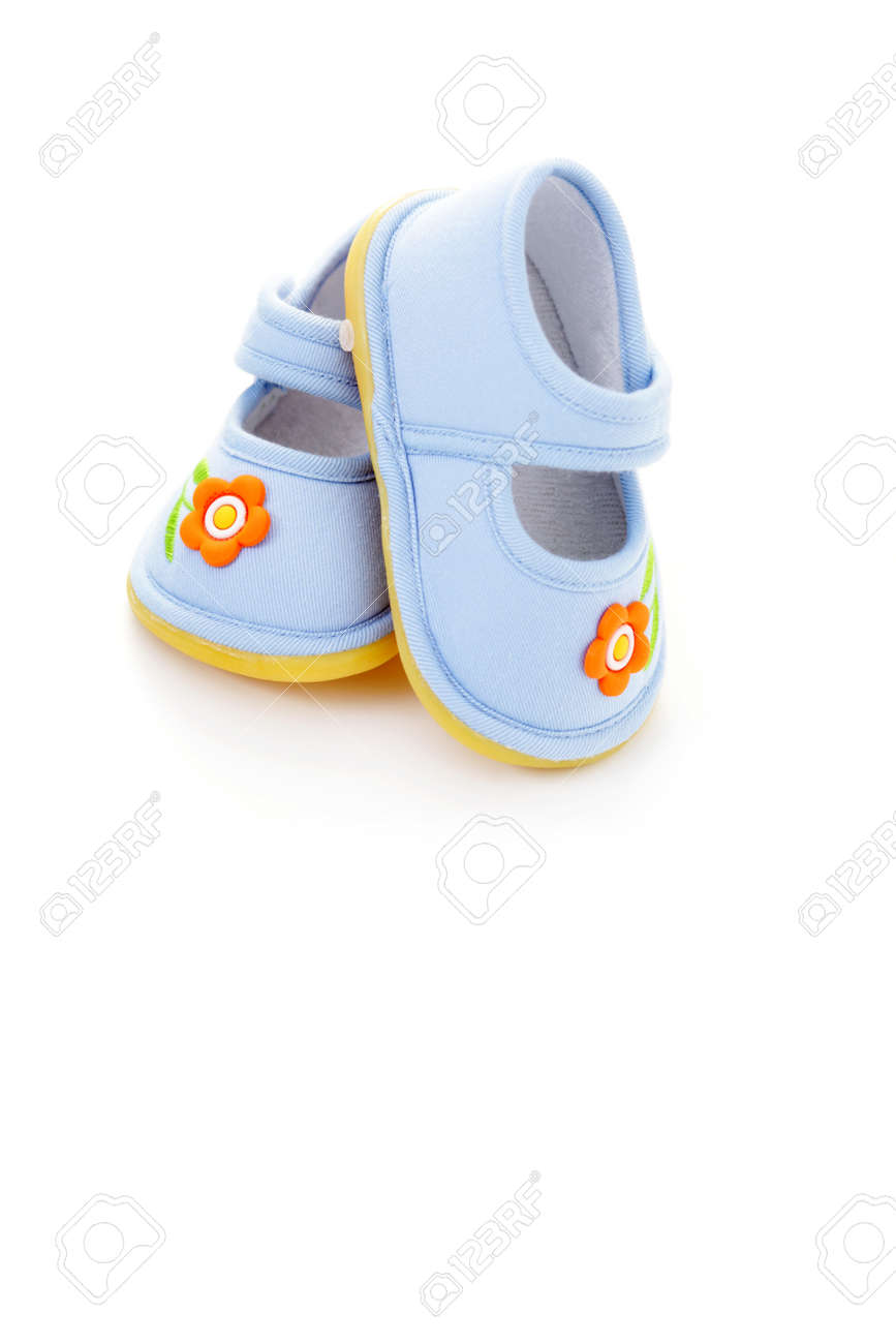 close-ups of blue baby shoes on white - baby stuff Stock Photo - 10342888
