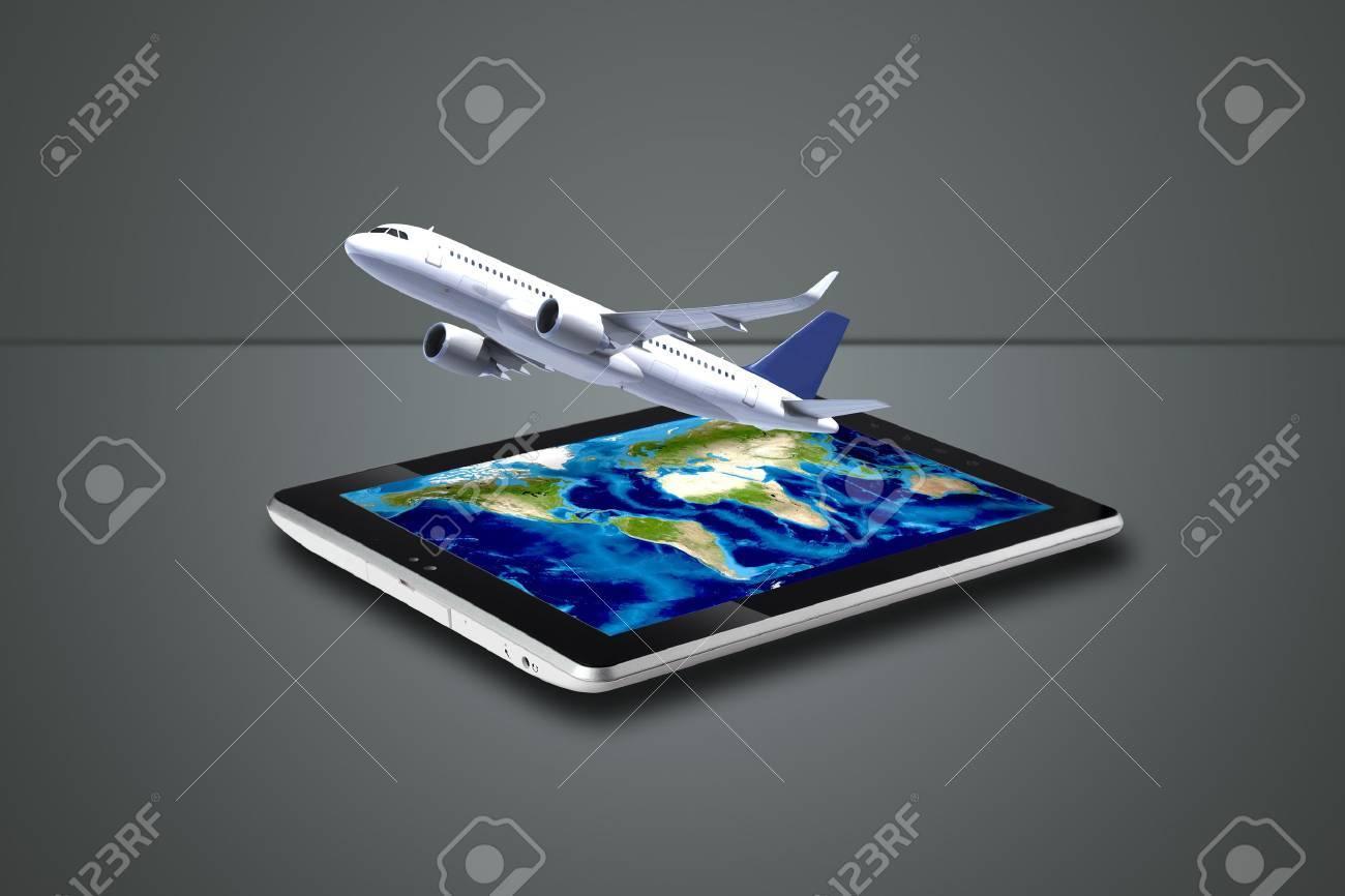 灰色のもたらされるデジタル タブレットから飛んでいる飛行機羽の背景