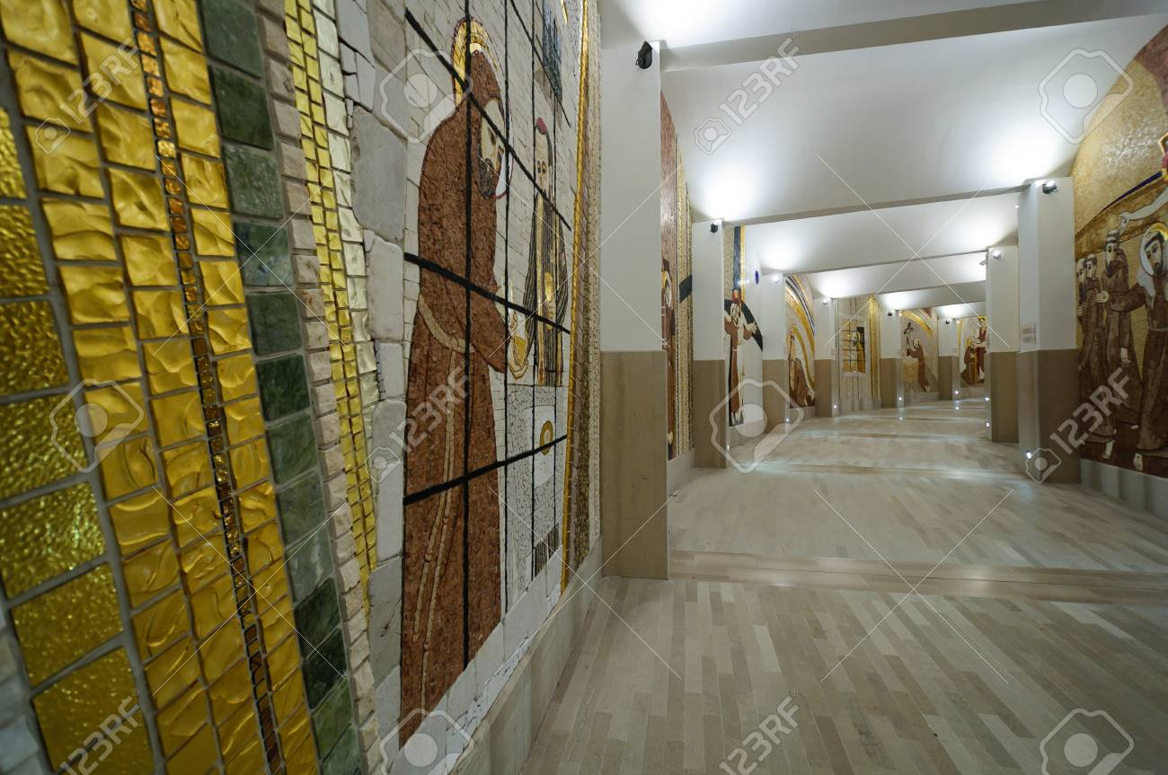 View of the circular corridor with mosaics depicting the life of St Pio and St Francis of Assisi. Stock Photo - 12193947