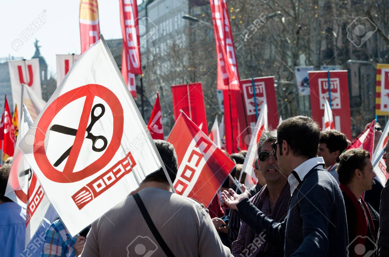 BARCELONA, SPAIN - MARCH 11, 2012: Thousands of protestors demonstrated at Passeig de Gracia in Barcelona to take part of the massive demonstrations with tens of thousands of participants across Spain against the conservative governments new labor laws Stock Photo - 12592167