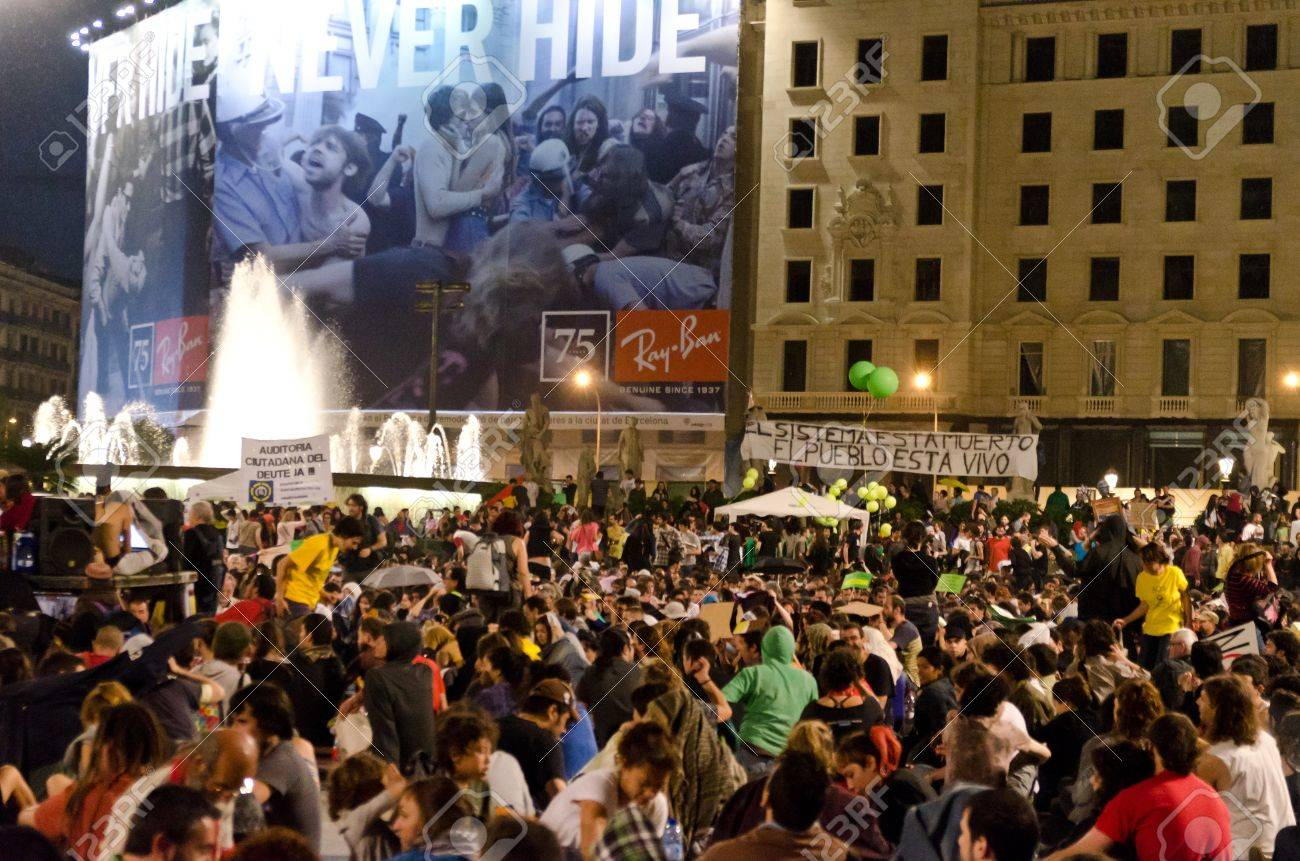 After a peaceful manifestation of several thousand 'Indignados' filled the Plaza Catalunya, the epicenter of the 15M movement, activists hold an assembly and prepare to hold the space until the 15th of May, in Barcelona, Spain on May 12th, 2012. Stock Photo - 13669229