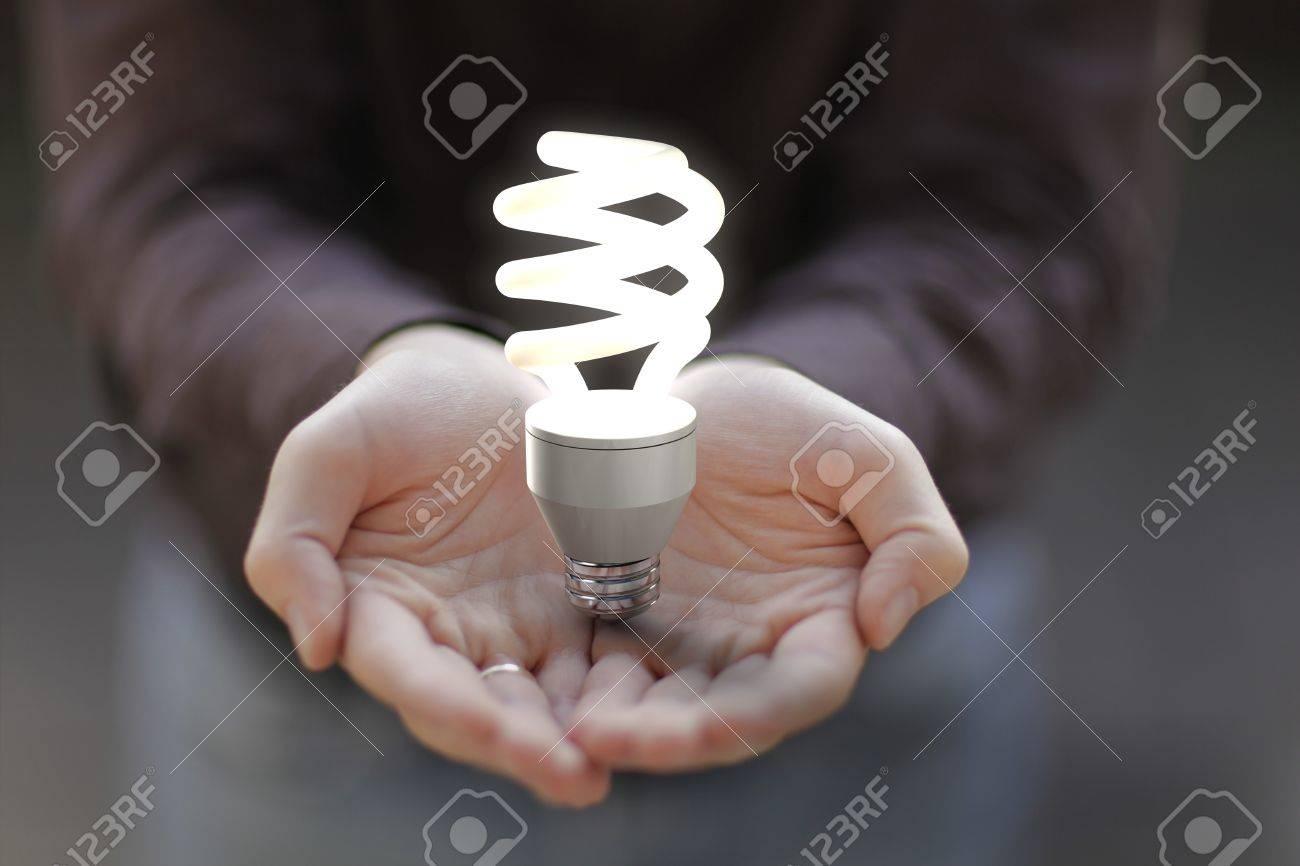 Light bulb on hands. Stock Photo - 7321742