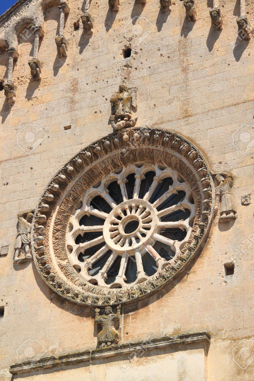 Exterior of the rose window (or Catherine window) of an ancient church Stock Photo - 12615442