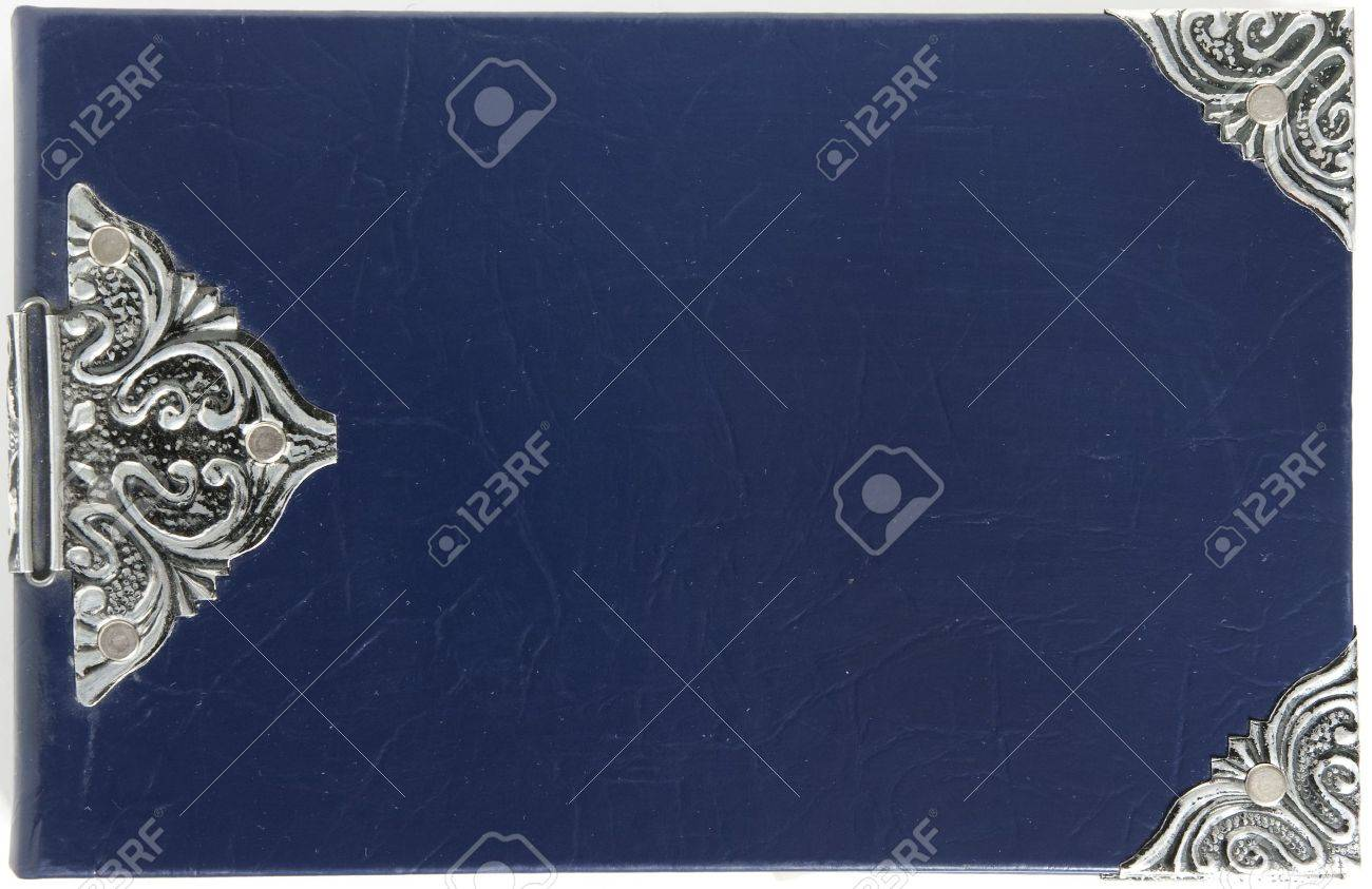 blue vintage book cover with metal corners shot from above Stock Photo - 7602691