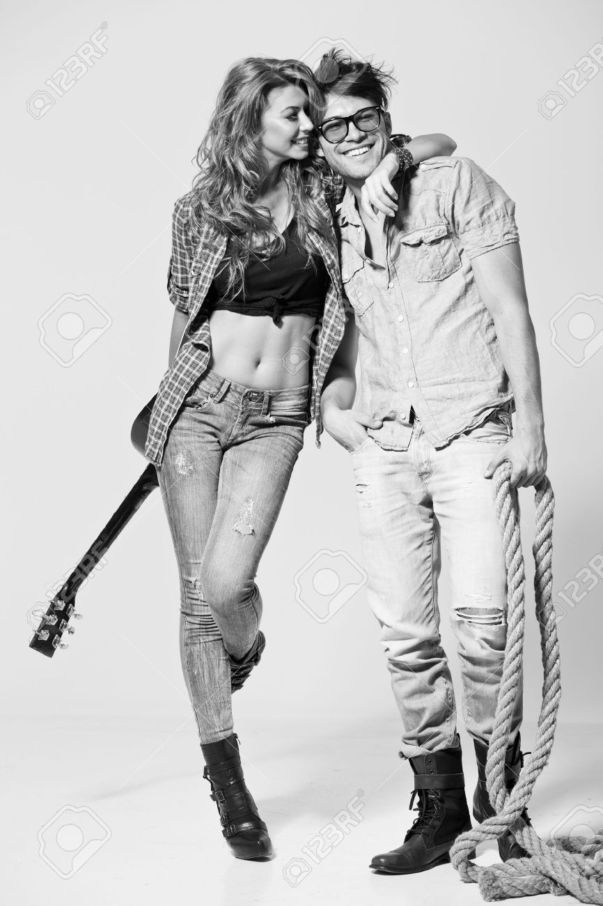 Sexy man and woman doing a fashion photo shoot in a professional studio - bw retro mood Stock Photo - 16865158