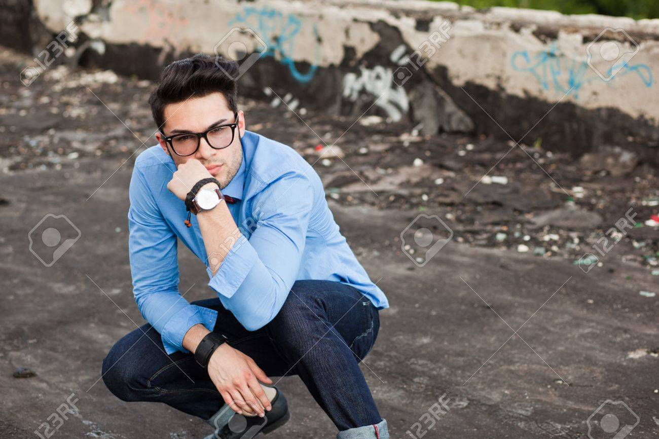 attractive young male fashion model dressed casual - outdoor Stock Photo - 16866467
