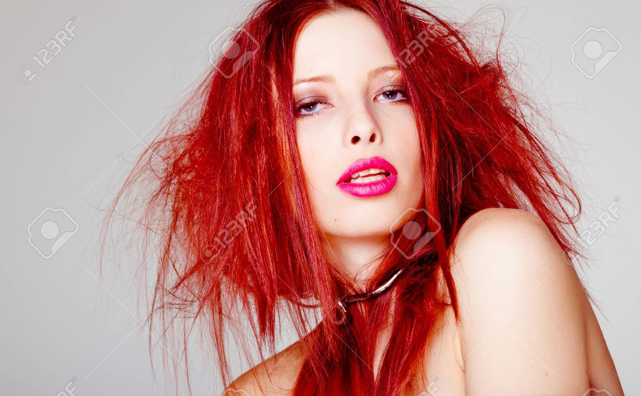 sexy red haired woman, punk attitude posing in the studio Stock Photo - 17492390