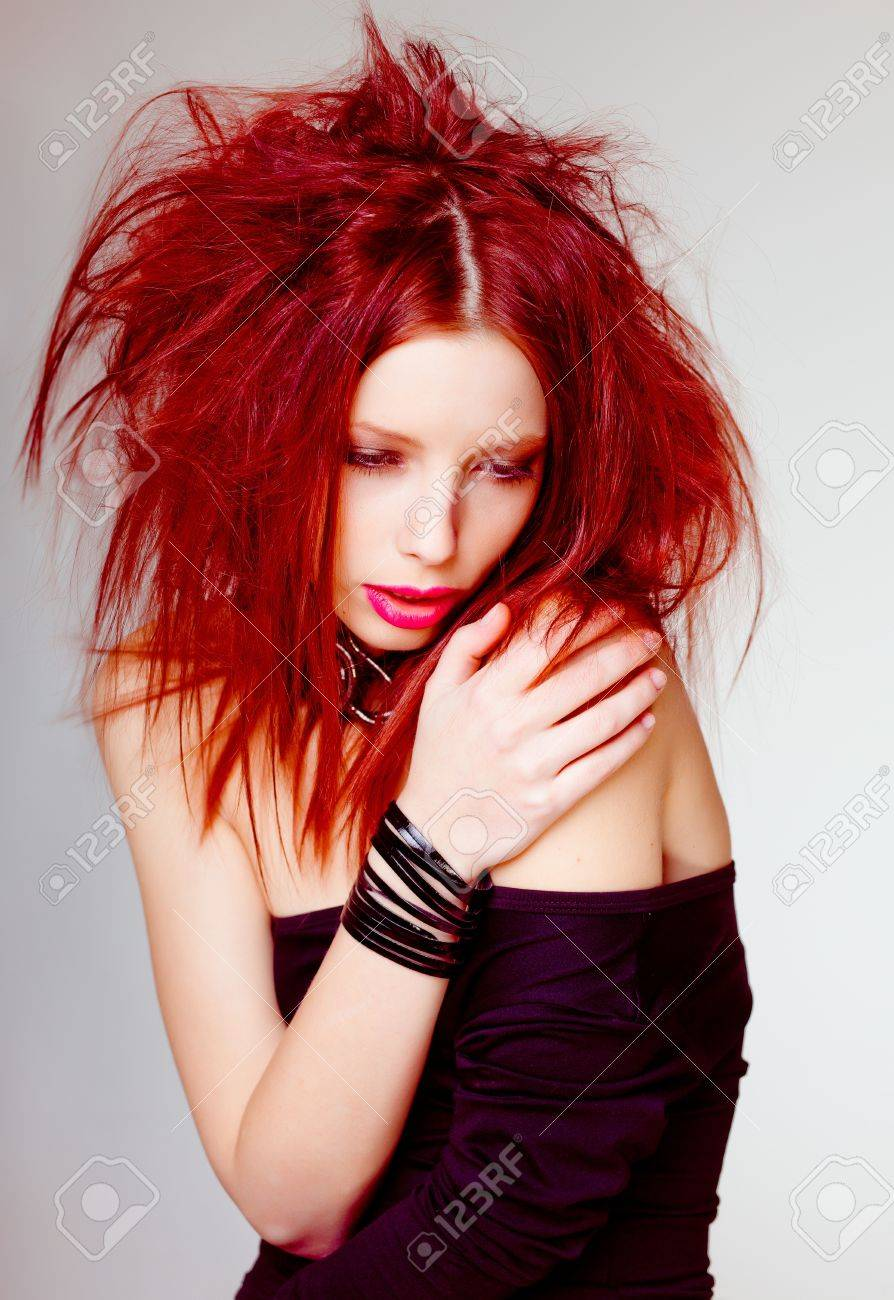 sexy red haired woman, punk attitude posing in the studio Stock Photo - 17501755