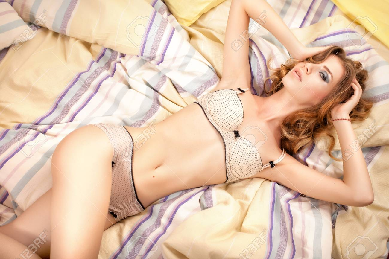 sexy woman lying in bed dressed in lingerie Stock Photo - 21307550