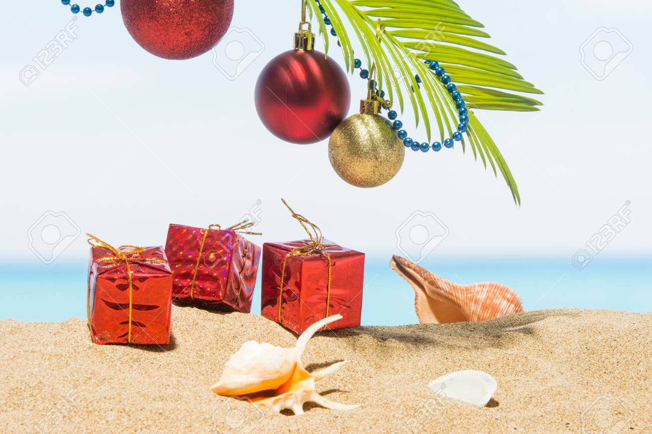 christmas tree decorations on the beach in tropical concept stock