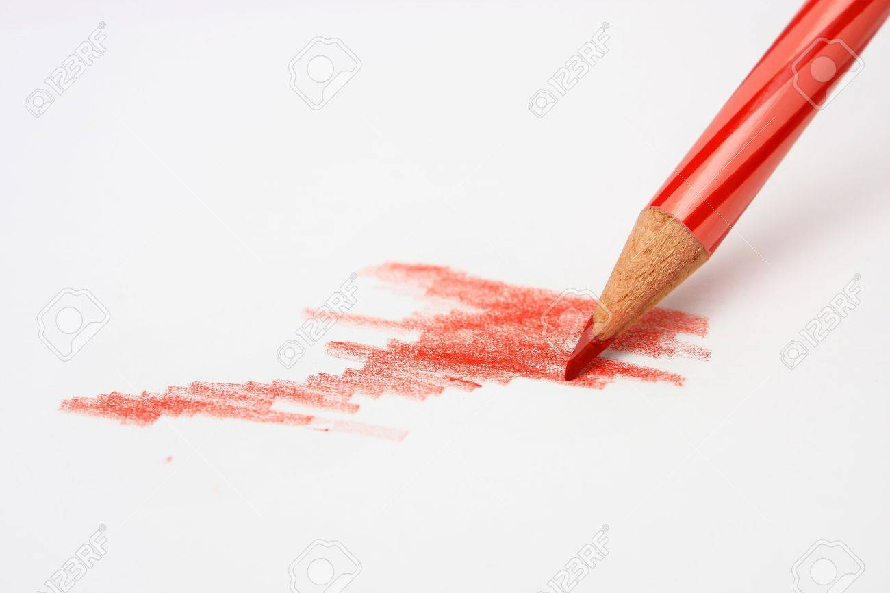 A red color pencil sketching and coloring on a white paper stock photo 2854293