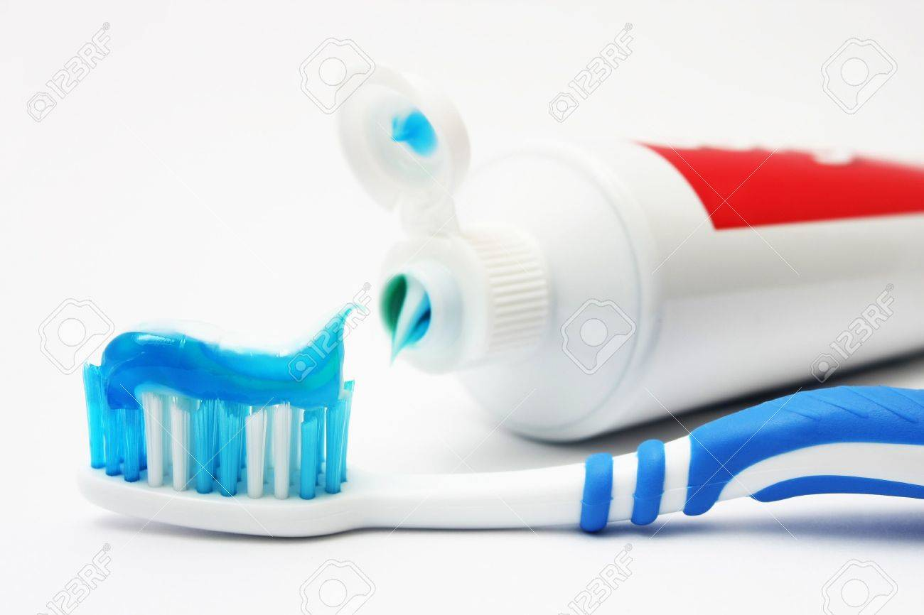 Blue dental brush with tooth paste on white background. - 3108330