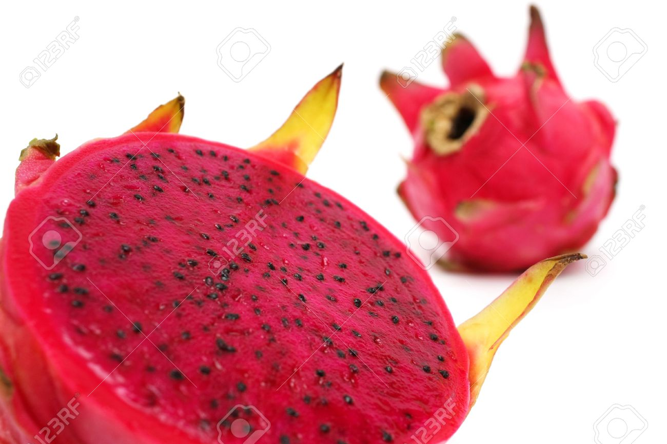 Close up of an half red dragon fruit over white background. - 3122171