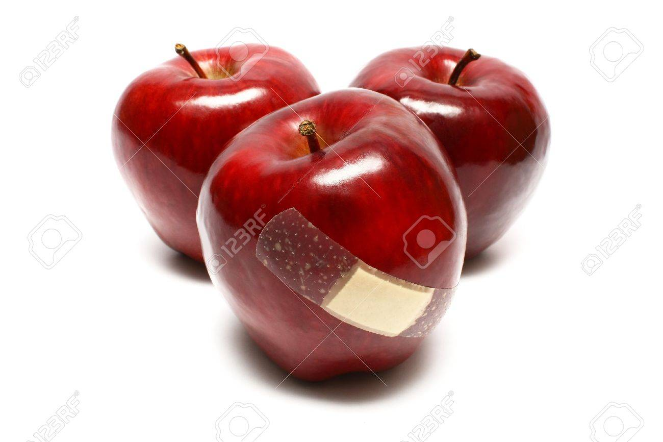 Injured apples with plaster on white background. - 3244144