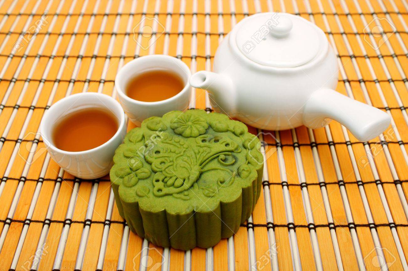A greentea mooncake put together with teacup and teapot. - 3369522