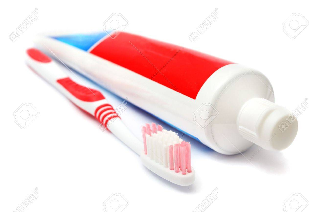 Tooth brush beside toothpaste on white background. - 4161370