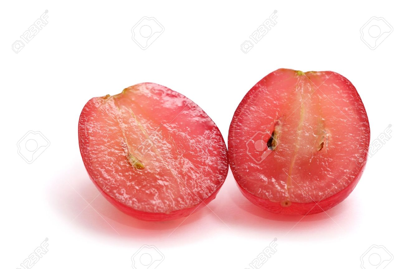 A red grape sliced into half isolated on white background. - 4606605