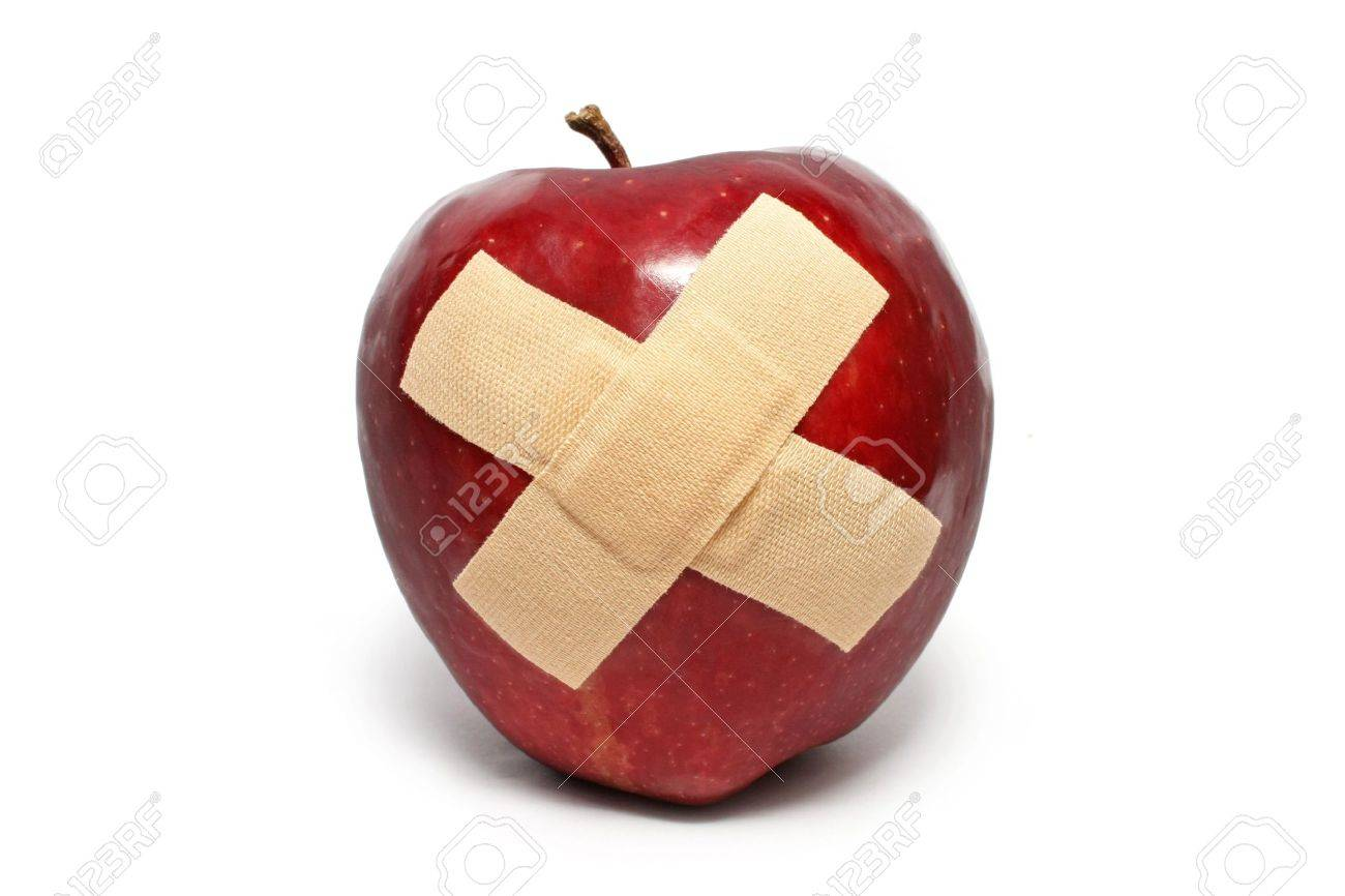 An injured red apple with plaster on it isolated over white background. - 7500774