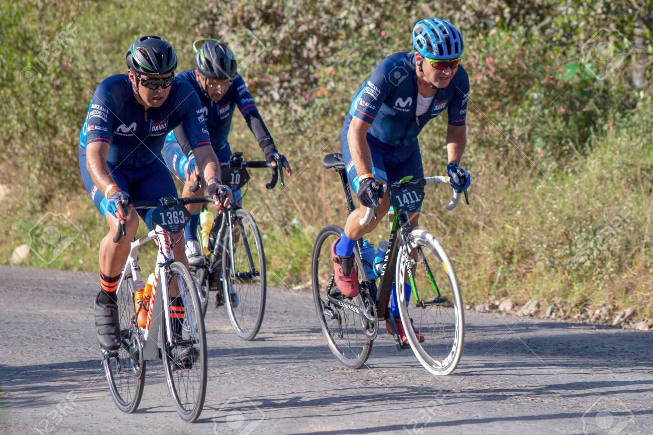 Villa de Leyva, Boyaca, Colombia - December 1, 2019: Men and women of all ages ride bicycles during the development of the Gran Fondo Nairo Quintana cycling event, in which Nairo Quintana and Egan Bernal participated. - 142484747