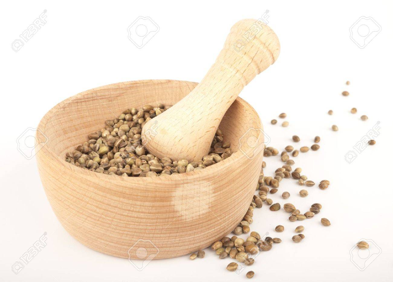 Hemp seed in wooden pounder isolated on white - 10396612