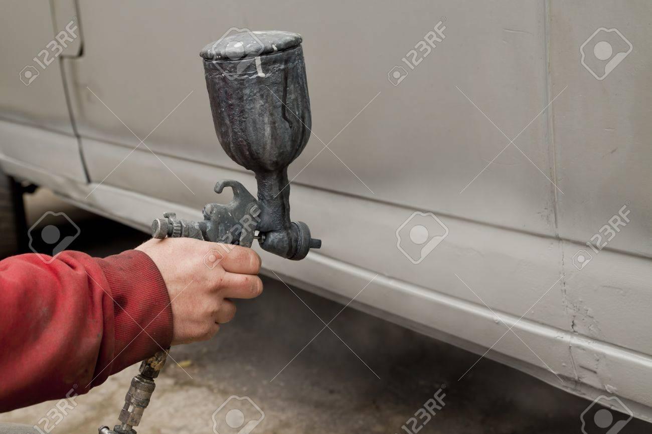 Hand holding spray paint gun - 11449729