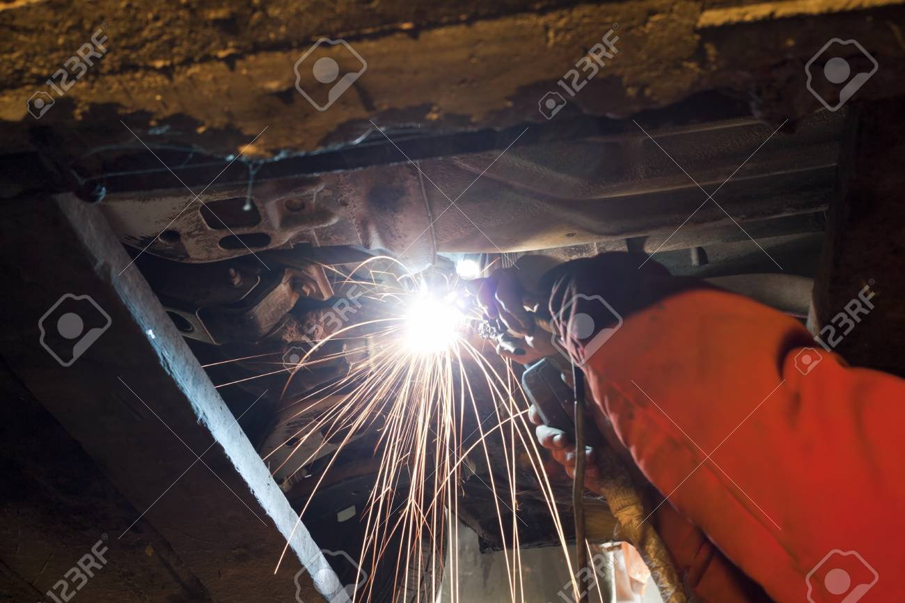 Welding works in the repair shop Stock Photo - 11449831