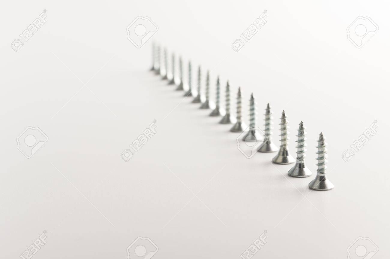 screws on the grey background Stock Photo - 11937114