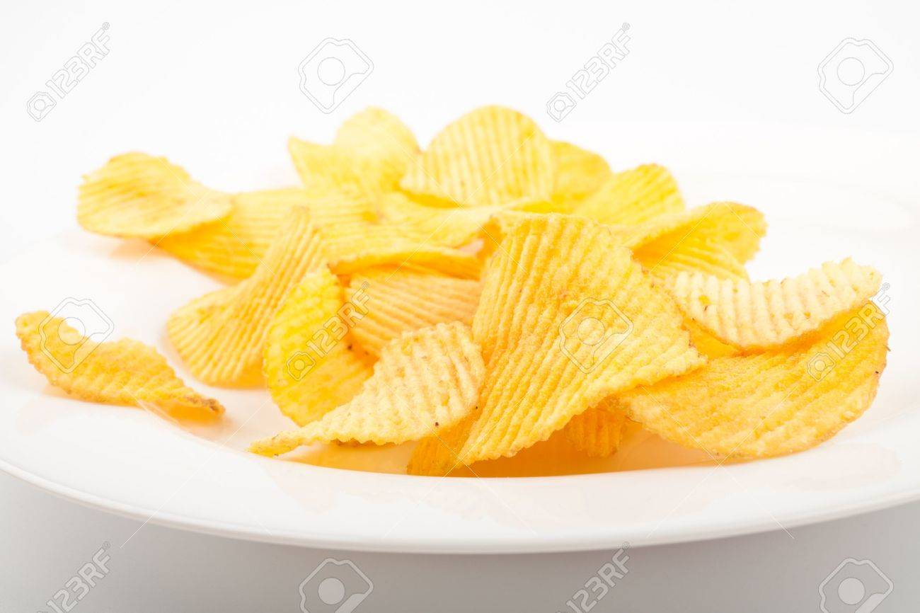 Potato chips heap on the white plate - 11966780