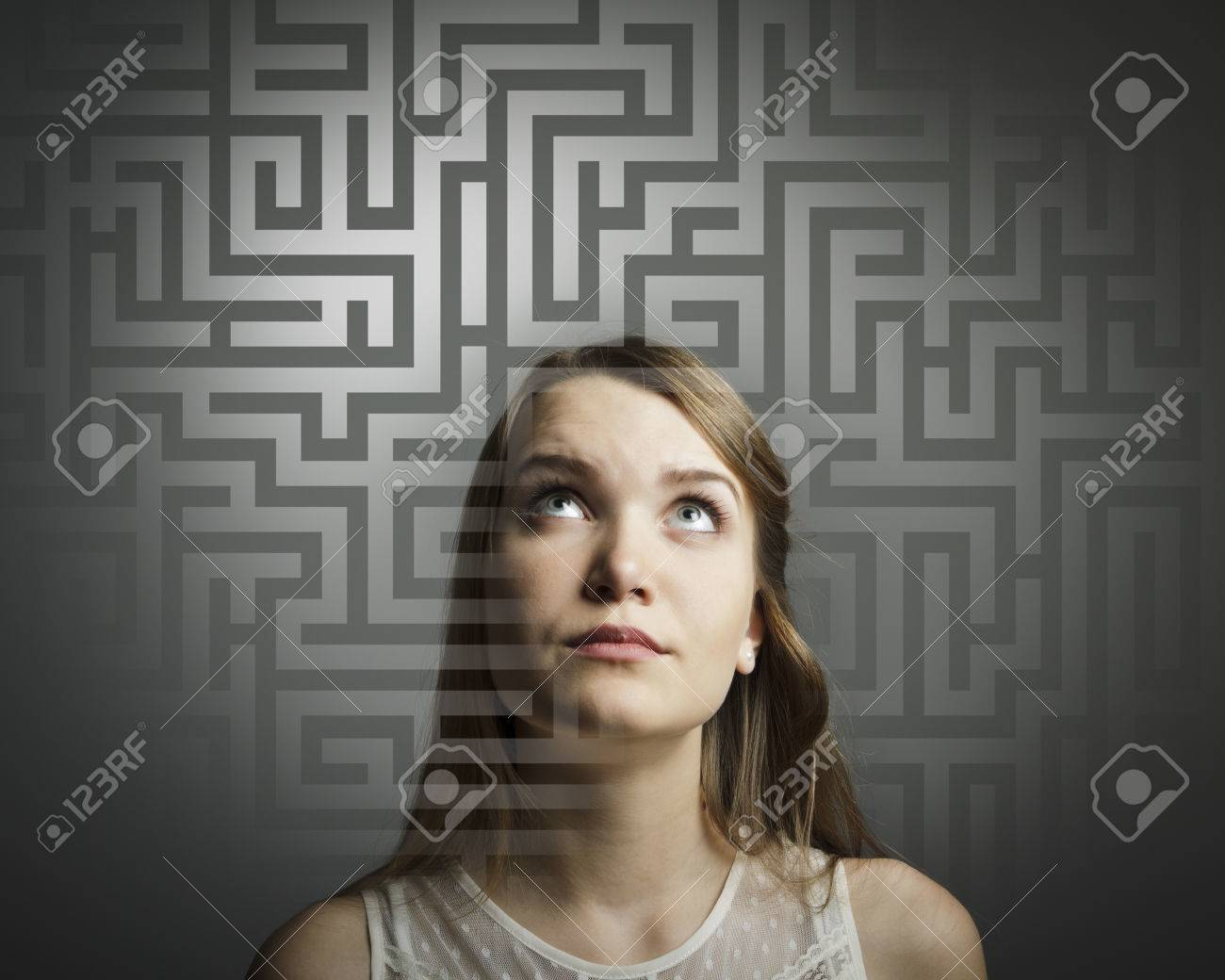 Girl in white full of doubts and hesitation Girl looking for the solution - 24831733