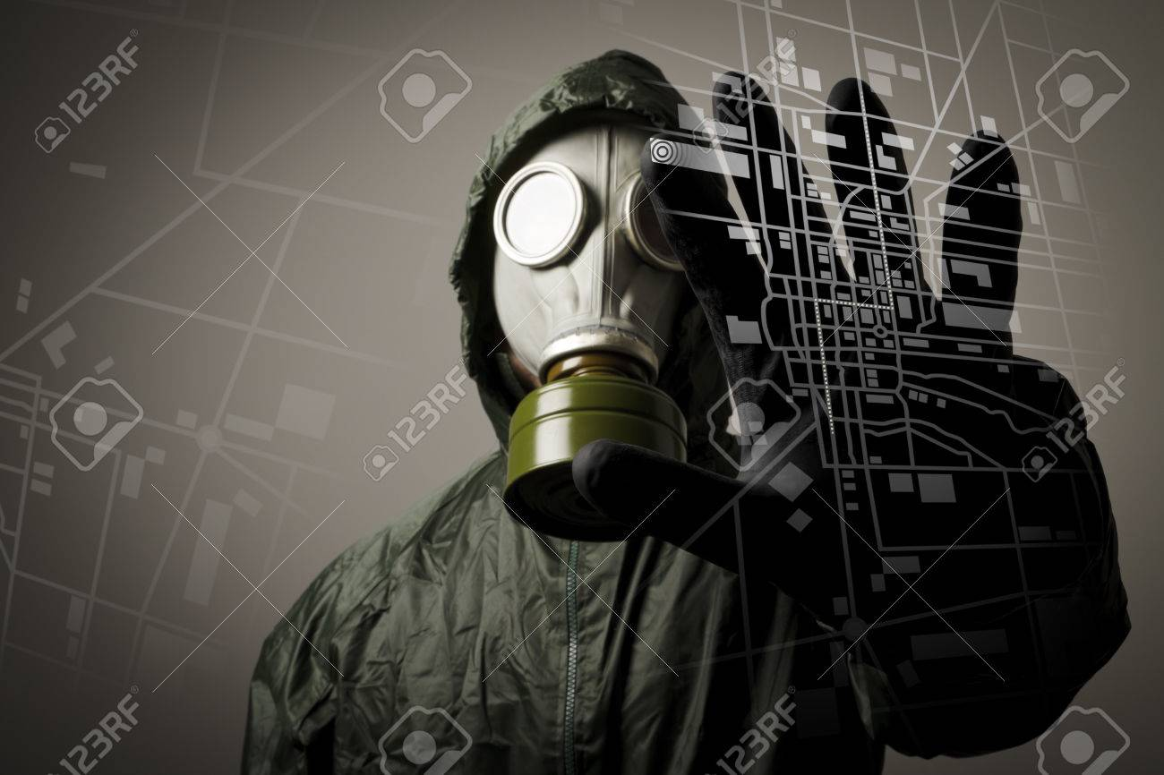 Man wearing a gas mask on his face Gas mask and city map Evacuation concept - 27884200