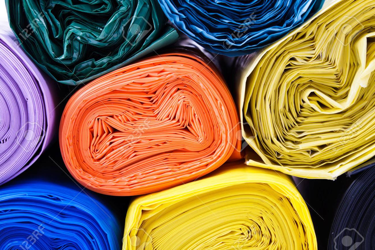 Colored garbage bags on white background - 69653314