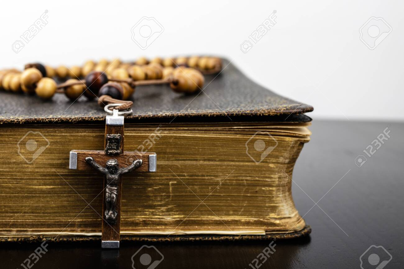 Rosary beads and prayer book. Rosary and book of Catholic Church liturgy. - 125886554