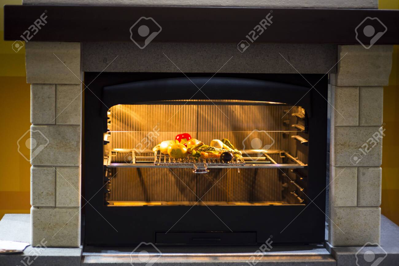 picture of cooking in a stone oven - 148356420