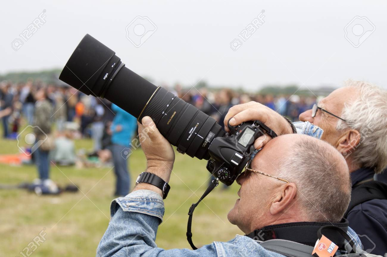 LEEUWARDEN, THE NETHERLANDS - JUNE 11 2016: Photographer with a Nikon  camera and Sigma