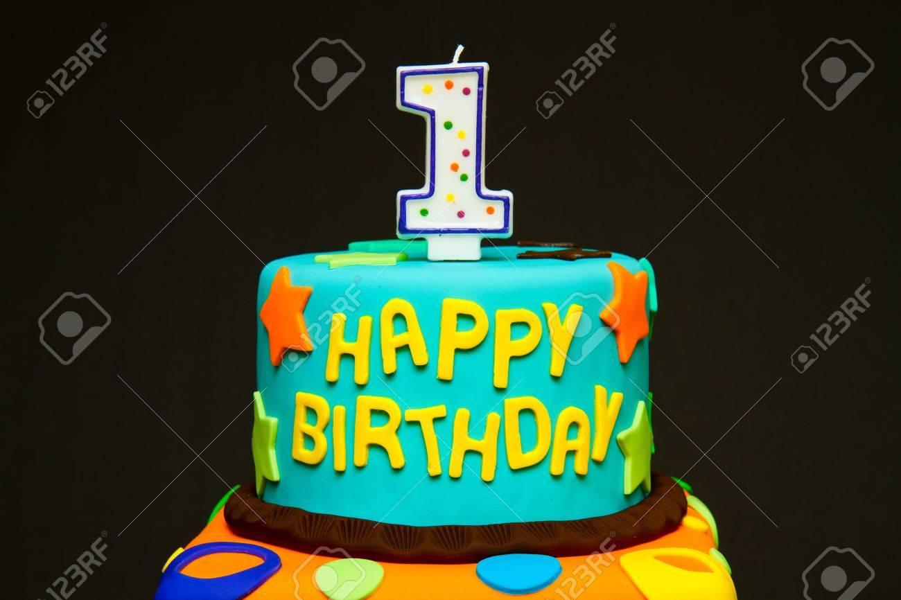 Happy First Birthday Fondant Cake On A Dark Background Stock Photo
