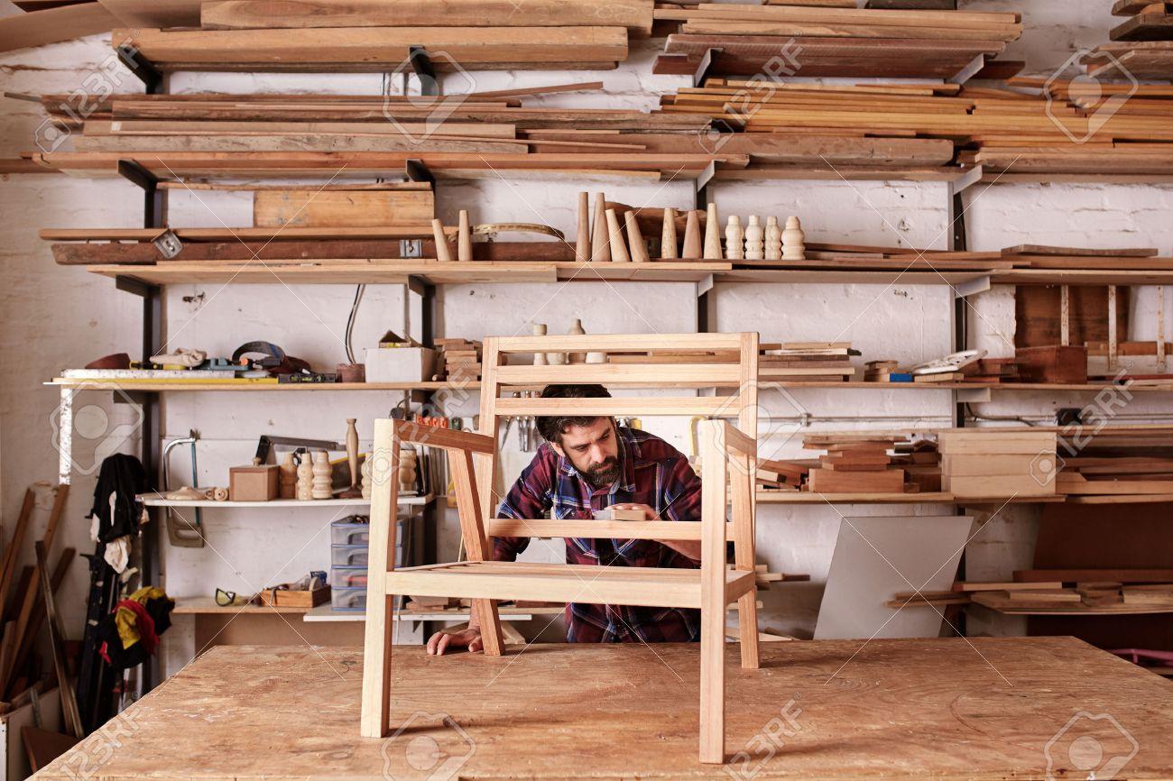 Artisan Furniture Designer And Carpenter In His Woodwork Studio